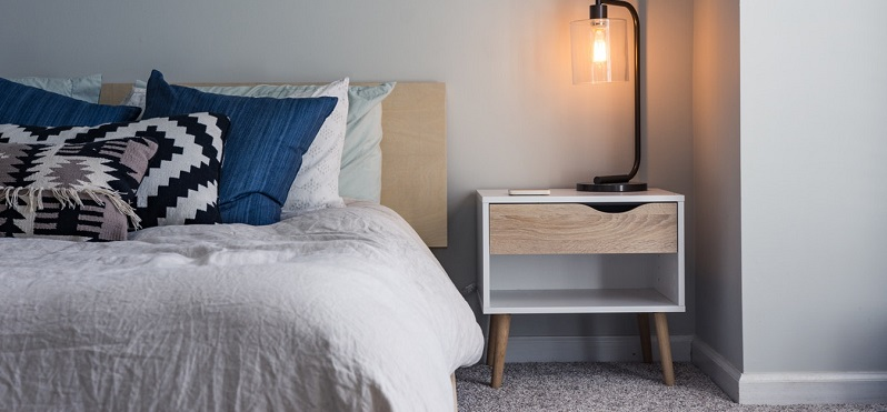 bed with bedside table