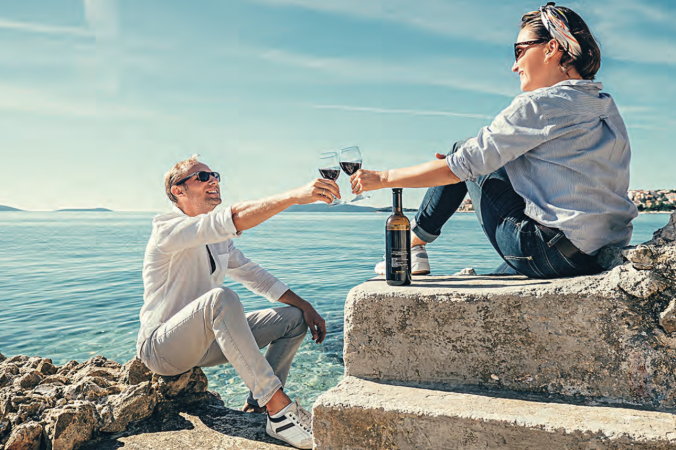 couple toasting wine glass abroad